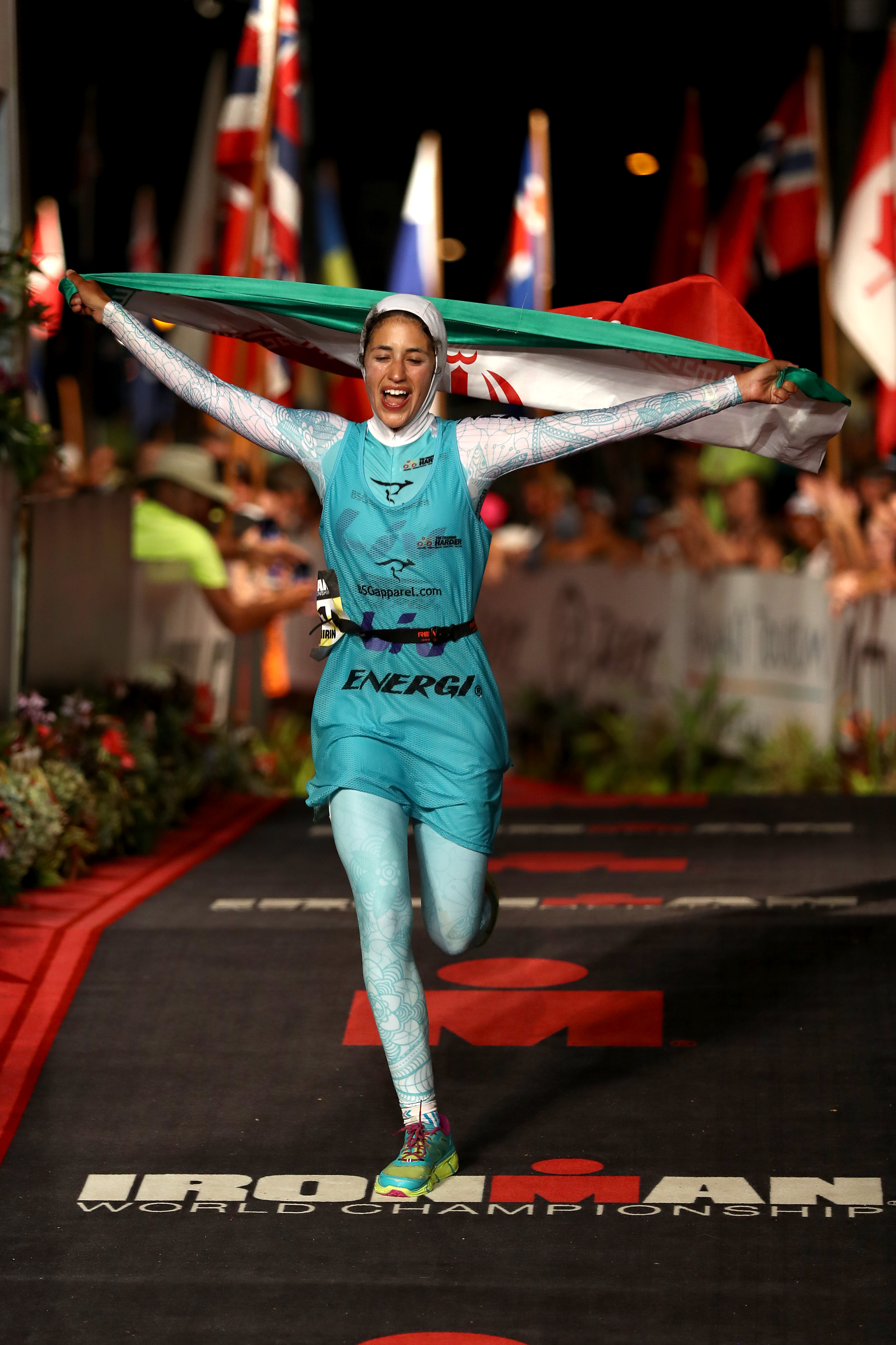 KAILUA KONA, HI - OCTOBER 08: Shirin Girami #151 of Iran reacts after crossing the finish line in the 2016 IRONMAN World Championship triathlon on October 8, 2016 in Kailua Kona, Hawaii. (Photo by Sean M. Haffey/Getty Images for Ironman)